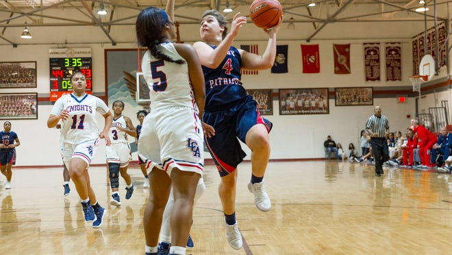 Kaylee Lopez drives to the basket as Lafayette Christian Academy girls basketball takes on North Vermillion in the Yultide tournament at Vermillion Catholic. Friday, Dec. 29, 2017.