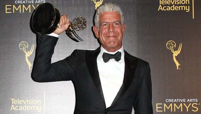 Bourdain poses in the press room at the 2016 Creative Arts Emmy Awards in Los Angeles.