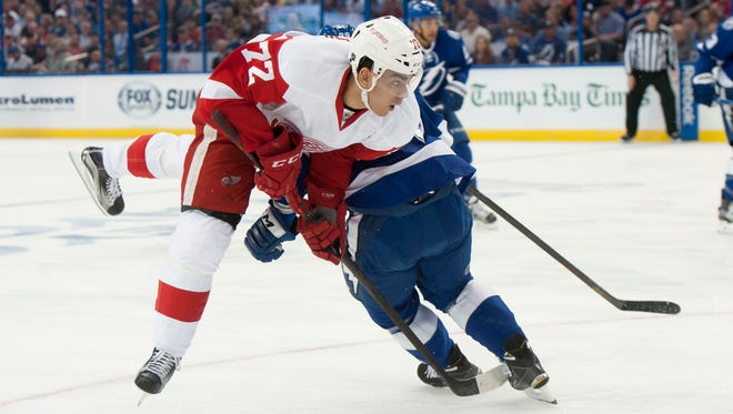 Andreas Athanasiou collides with Tampa Bay defenseman Nikita Nesterov in the first period of Game 1.