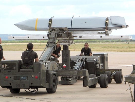 Airmen here prepare a Joint Air-to-Surface Standoff