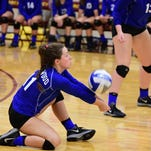 Ladywood's Madison Benoit tips the ball over the net Wednesday night against Mercy.