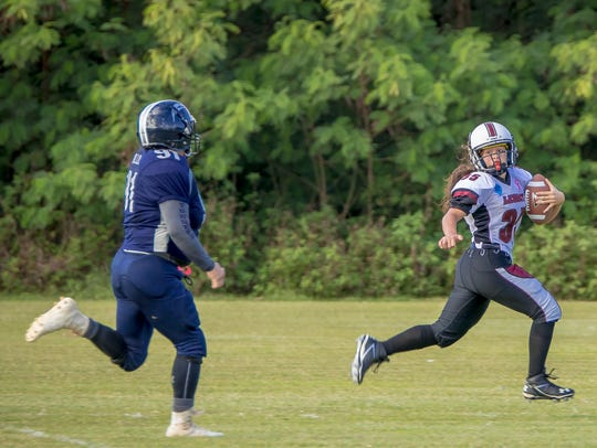 In this file photo, Jalana Garcia of Team Legacy heads for the end zone.