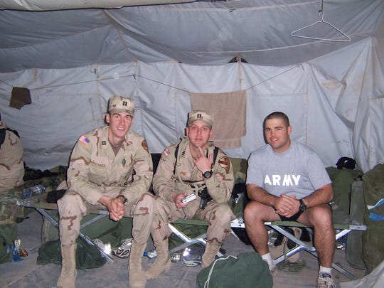 Capt. David Mathias with fellow 1st Cavalry officers in Kuwait, the night before they convoyed into Iraq.
