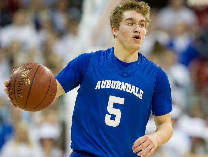 Auburndale's  Matthew Nikolay brings the ball up the