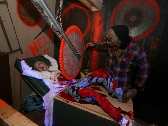 A gruesome scene is enacted at the Haunted Sawmill in Merrill. A gruesome scene is enacted at the Haunted Sawmill in Merrill, Friday, October 18, 2013.