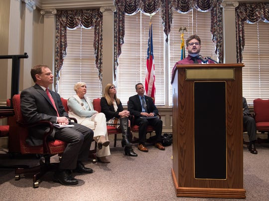 Matt Guthrie of Wilmington gives his first person account of his drug addiction during an announcement by Delaware attorney General Matt Denn to expand substance abuse treatment and reduce over-prescription of opioids during a press conference at Legislative Hall in Dover.