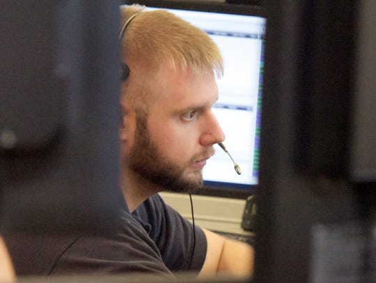 A worker takes a call at the York County 911 Center