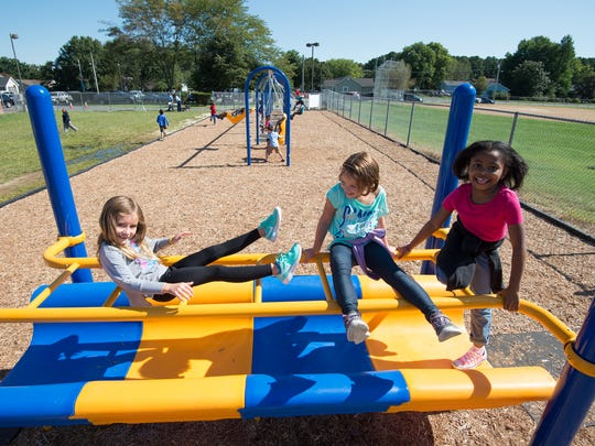 Students at Georgetown Elementary School play on their new adaptive playground.  The new playground equipment can accommodate all students, including those with disabilities.