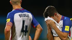 Michael Bradley and Christian Pulisic react after the