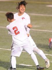 Cooper's Isiah Arratia celebrates with teammate Jose