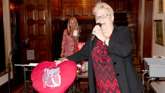 Heart disease survivor Diana Hartman of Lebanon shares her story at the 2016 Lebanon Go Red for Women Luncheon at Brasenhill Mansion in Lebanon.
