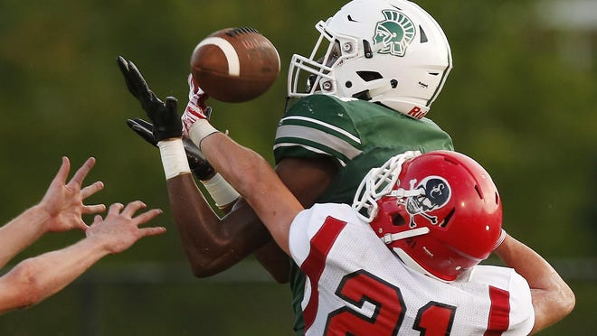 Athens Academy's Deion Colzie (18) brings in a pass for a touchdown two seasons ago.