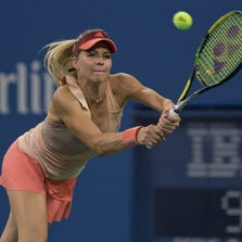 Maria Kirilenko (RUS) in action during her match against Maria Sharapova (RUS)  on day one of the 2014 U.S. Open tennis tournament at USTA Billie Jean King National Tennis Center.