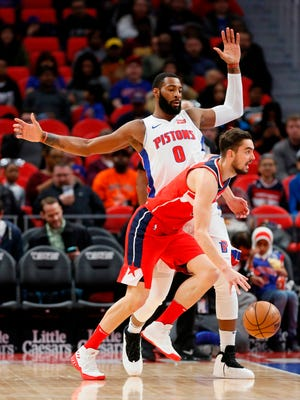 The Detroit Pistons' Andre Drummond guards the Washington Wizards' Tomas Satoransky during the first half.