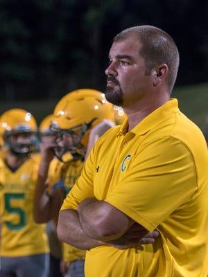 Catholic Crusaders new coach Matt Adams has a lengthy history with his school, after being an all-state quarterback, then coordinator under former coach Greg Seibert.