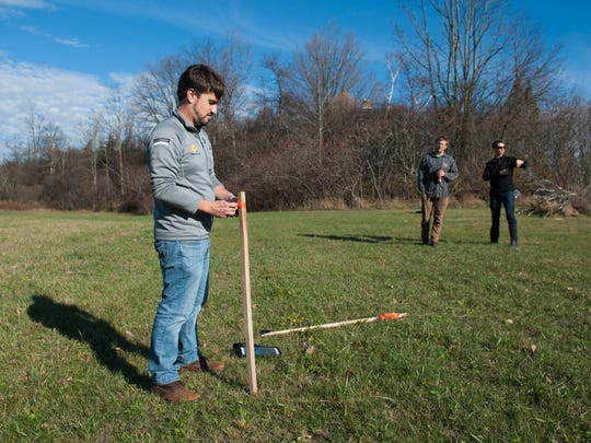 Sun Common's community solar advisor Mike McCarthy (left) ties a piece of ribbon around a stake during a site visit to Marilyn Brown's property on Thursday morning November 5, 2015 in Hinesburg. Marilyn is working with Sun Common to put a 150 kilowatt solar farm on an acre of her 10 acre farm.