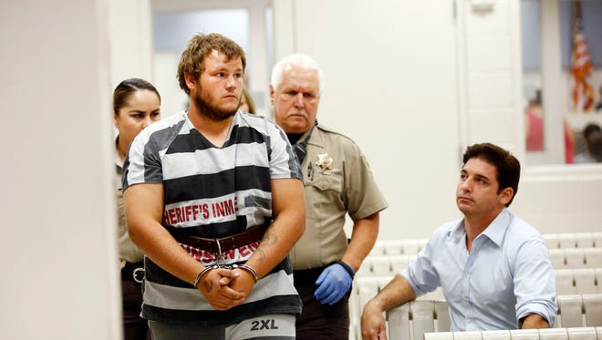 Leslie Allen Merritt Jr., makes his way to appear before a judge at the Maricopa County Sheriff's Office on Saturday, Sept. 19, 2015, in Phoenix. The landscaper is the suspect in a series of Phoenix freeway shootings and was arrested Friday after trying to sell a gun at a pawn shop.  (Rob Schumacher/The Arizona Republic via AP, Pool)