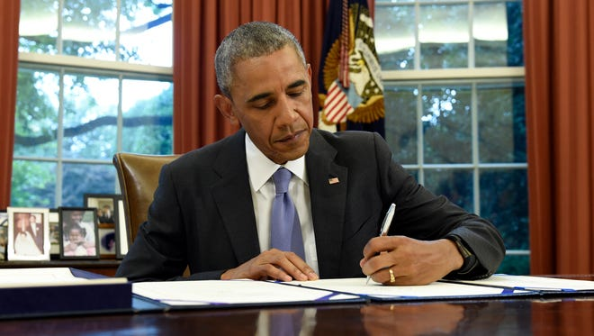 President Obama signs the FOIA Improvement Act of 2016 in the Oval Office Thursday. Obama also signed the Puerto Rico Oversight, Management, and Economic Stability Act.