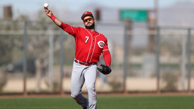 Cincinnati Reds third baseman Eugenio Suarez (7) throws to first base during fielding drills, Tuesday, Feb. 20, 2018, at the Cincinnati Reds Spring Training facility in Goodyear, Arizona.