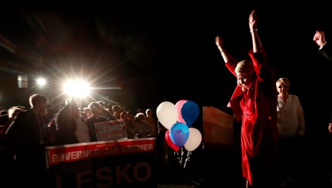 Republican U.S. Congressional candidate Debbie Lesko, right, celebrates after her congressional win, Tuesday, April 24, 2018, at her home in Peoria, Ariz.