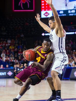 Arizona State guard Gerry Blakes (left) drives around Richmond forward Alonzo Nelson-Ododa during the second half of an NCAA college basketball game in the NIT in Richmond, Va., on March 22, 2015. Richmond won 76-70 in overtime.