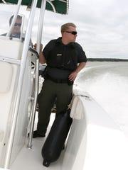 Brooks Vanderbeek of the Iowa DNR patrols watercraft on Saylorville Lake on Saturday, May 23, 2015.
