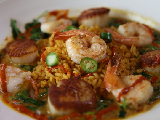 Spicy curried shrimp and scallops at Ox and Stone at 282 Alexander Street in the East End district of Rochester.