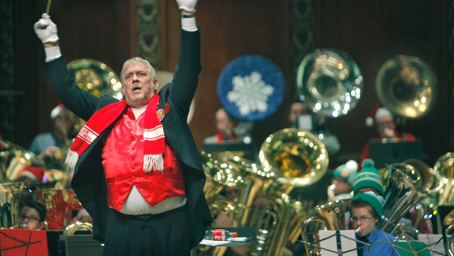 Glenn K. Call engages the audience as he conducts during Rochester's 32nd Annual Tuba Christmas concer at the Hochstein School of Music & Dance Performance Hall on Saturday, sponsored by the city of Rochester.
