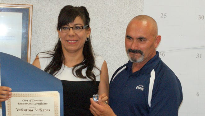 Valentina Villezcas was presented with a retirement certificate by Mayor Benny Jasso.