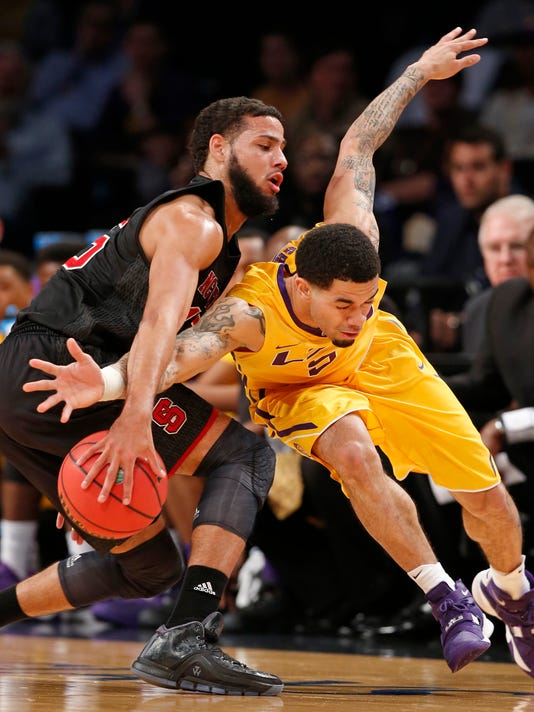 North Carolina State guard Cody Martin, left,steals the ball from LSU guard Josh Gray (5) during the first half of an NCAA college basketball game for third place in the Legends Classic, Tuesday, Nov. 24, 2015, in New York. (AP Photo/Kathy Willens)