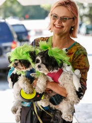 Eileen Kolasa poses with her dogs Sonny and Popcorn