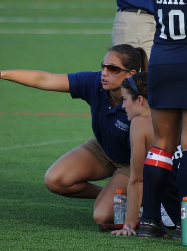 Amanda Strous (pointing) was an assistant coach in 2013 when the Shippensburg field hockey team won its first NCAA Division II National Championship.