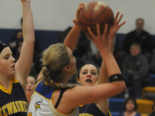 Abby Baumgartner of Kewaunee, right, gets a hand on the ball driven into the lane by Makenna Ash of Gibraltar during first half of the Jan. 6 game at Gibraltar. Also defending is Ellie Olsen of Kewaunee, left.
