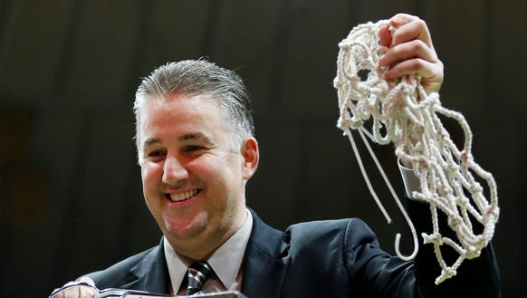 Head coach Matt Painter cuts down the nets after Purdue