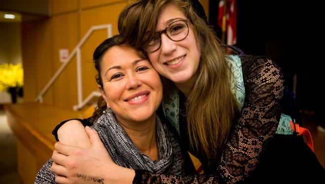 """Chasilee and Zay Crawford  of Yellow Springs pose for a portrait during the """"Community in Action: Caring for Our Transgender Children and Youth"""" conference at Children's Hospital Saturday, November 18, 2017."""