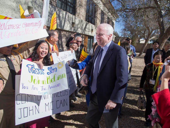 Sen. John McCain is greeted with cheers and signs from