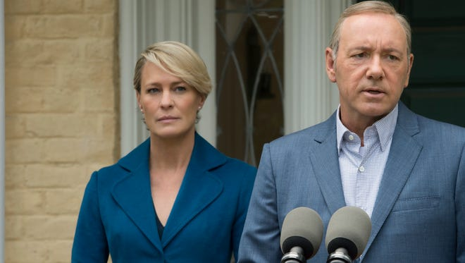 """Robin Wright, left, and Kevin Spacey in a scene from """"House of Cards.""""  Both earned Primetime Emmy nominations for their roles in the series."""