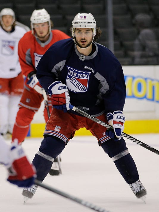 New York Rangers' Mats Zuccarello, center, of Norway, skates during practice for Wednesday's Game 1 of the NHL Stanley Cup Final hockey series against the Los Angeles Kings on Tuesday, June 3, 2014, in Los Angeles. (AP Photo/Jae C. Hong)
