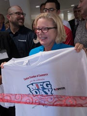 Canton Township Clerk Dian Slavens holds a T-shirt