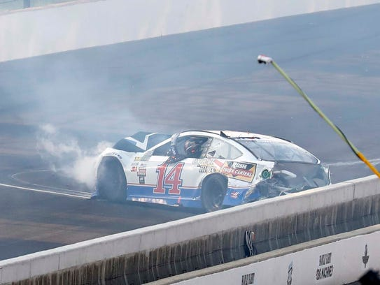 Clint Bowyer (14) in the front straightaway during