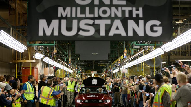 Ford's Flat Rock Assembly Plant employees cheer as the millionth Ford Mustang is driven off the assembly line in Flat Rock, Mich., in April 2013.