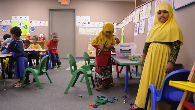 Kids play in a classroom in August at the now-closed Hashiro Child Care Center.