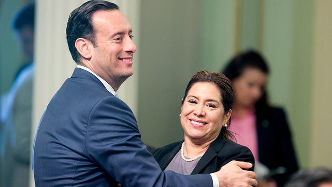Assemblyman Roger Hernandez, D-West Covina and Assemblywoman Nora Campos, D-San Jose, celebrate after a bill to raise the state's minimum wage was approved by the Assembly, Thursday, March 31, 2016, in Sacramento, Calif. The bill SB3, to gradually raise California's minimum wage to a nation leading $15 an hour by 2022, passed by a 48-26 vote and sent to the Senate.