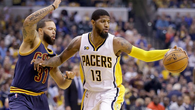Indiana Pacers forward Paul George (13) holds off the defending Cleveland Cavaliers guard Deron Williams (31) in the first half of their NBA playoff basketball game Sunday, April 23, 2017, afternoon at Bankers Life Fieldhouse.