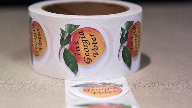Absentee ballot applications went in the mail Friday to all Richmond County voters for the Nov. 3 presidential election.
