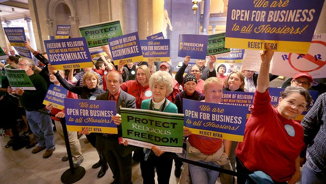 """Supporters and opponents of Senate Bill 101, the """"religious freedom"""" bill, are shown standing outside the House chambers on March 19, 2015, at the Indiana Statehouse."""