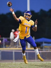 Wren junior Tyrell Jackson (1) passes in the game with Palmetto during the first quarter at Wren High School in Piedmont on Friday.
