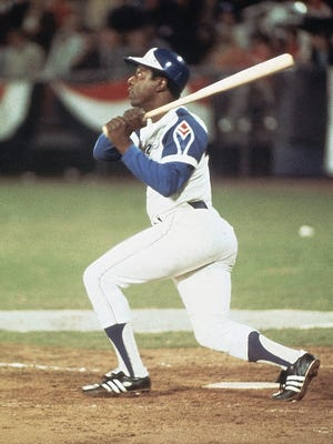 Hank Aaron hits home run No. 715 to break Babe Ruth's record.