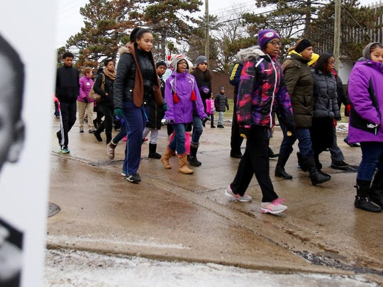 People of various backgrounds and ages participate in the 30th Annual Peace Walk Celebration Monday, Jan. 19, 2015 honoring the birthday of Dr. Martin Luther King, Jr. in Southfield. The walk begins at Hope United Methodist Church and ends at the Southfield Pavilion.