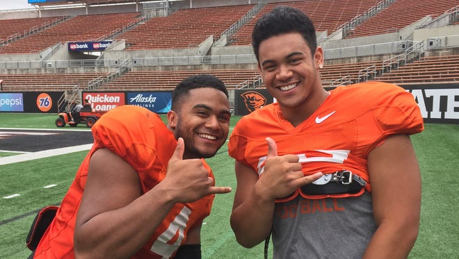 Oregon State running back Jaylynn Bailey (right) with teammate Thomas Tyner after Saturday's scrimmage at Reser Stadium on Aug. 12, 2017.